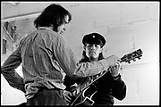 "Fall River, Massachusetts - 18 February 1968. Ian Underwood (left) and Jim ""Motorhead"" Sherman of The Mothers of Invention prior to a performance. © 2020 Ed Lefkowicz"