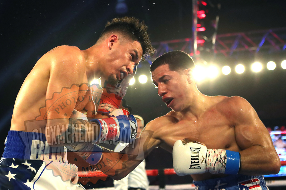 """KISSIMMEE, FL - MAY 25: Jean Carlos """"Chapito"""" Rivera (R) punches Adam Lopez during their Jr. NABF Featherweight Title fight at Osceola Heritage Park on May 25, 2019 in Kissimmee, Florida. (Photo by Alex Menendez/Getty Images) *** Local Caption *** Jean Carlos Rivera; Adam Lopez"""