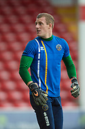 Craig MacGillivray of Shrewsbury Town warms up ahead of the EFL Sky Bet League 1 match between Walsall and Shrewsbury Town at the Banks's Stadium, Walsall, England on 7 October 2017. Photo by Darren Musgrove.