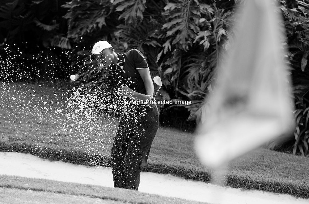 Toto Thimba, a graduate of the Ernie Els Fancourt Foundation for talented young golfers, warms up before competing in the Vusi Ngubeni Qualifying School -- an opportunity for minority golfers to play their way into a spot on the Sunshine Tour.