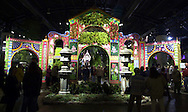 """Patrons wlak through the entrance at a preview of the Philadelphia Flower Show, Saturday, March 2, 2002, in Philadelphia, Pa. The Philadelphia Flower Show runs from March 3-10, and is the largest indoor flower show in the world. This years theme is """"The Pleasures of the Garden."""" (Photo by William Thomas Cain/photodx.com)"""