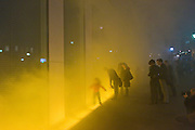 "Presentation of Olafur Eliasson's ""Yellow Fog"" on the Facade of Verbund's ""Am Hof"" Building in Vienna. From today, the center of Vienna acts as showcase for Verbund's permanent presentation of the artwork ""Yellow Fog"" - Olafur Eliasson's first intervention in a public space in Vienna. Olafur Eliasson is one of the most renowned artists of modern times. His impressive work ""Yellow Fog"" first shown in New York in 1988 can now be seen exclusively and permanently in Vienna. The site of the interventions are the Verbund building and the historic ""Am Hof"" square, which will be transformed daily into a public stage for a show of light and fog during the hours of dusk..Embedded in the pavement along the front of Verbund's headquarters is a framework containing 32 luminescent tubes, providing a broad, uniform light. After the fall of dusk, fog rises for approximately 40 seconds in a yellow light upwards to the height of the facade. In intervals of approximately three minutes, the process is repeated and envelops the building in a momentary fog over the course of one hour."