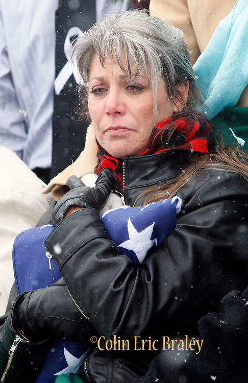 Teena Nemelka, mother of fallen U.S. Army Pfc. Aaron Nemelka, clutches an American flag that covered her son's casket during a burial ceremony at Camp Williams Nov. 14, 2009 in Riverton, Utah. Nemelka was one of 13 gunned down at Fort Hood, Texas. (AP Photo/Colin Braley)