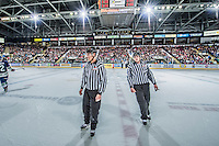 KELOWNA, CANADA - JANUARY 16: WHL officials, linesman Bevan Mills and ____ stand on the ice on January 16, 2015 at Prospera Place in Kelowna, British Columbia, Canada.  (Photo by Marissa Baecker/Shoot the Breeze)  *** Local Caption *** officials; linesman; Bevan Mills;