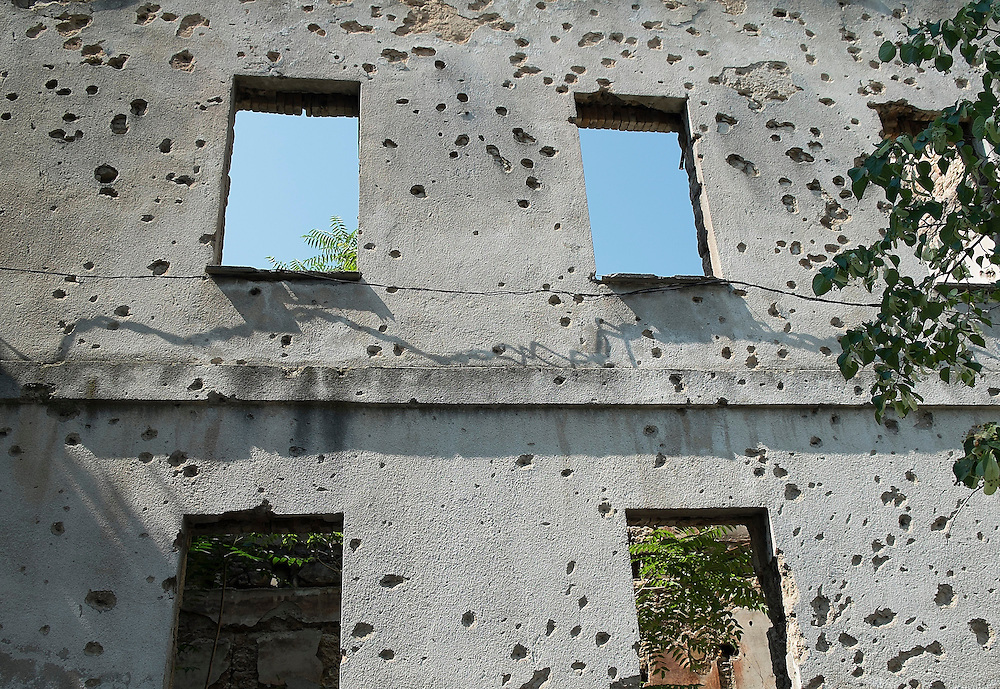 MOSTAR, BOSNIA AND HERZEGOVINA - JUNE 28:  A concrete wall damaged by bulletts from the 1993 war is seen on June 28, 2013 in Mostar, Bosnia and Herzegovina. The Siege of Mostar reached its peak and more cruent time during 1993. Initially, it involved the Croatian Defence Council (HVO) and the 4th Corps of the ARBiH fighting against the Yugoslav People's Army (JNA) later Croats and Muslim Bosnian began to fight amongst each other, it ended with Bosnia and Herzegovina declaring independence from Yugoslavia.  (Photo by Marco Secchi/Getty Images)