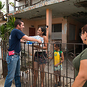 Toa Baja, PR, November 10, 2017--Jes˙s Pag·n Torres, left, and Moriama CortÈs, right, are part of a team of faculty and staff of Escuela Delia Cab·n who continue to distribute water and emergency relief in Tao Baja, PR neighborhoods still without power and water 50 days after Hurricane Maria.  Escuela Delia Cab·n has served as a distribution point for the Puerto Rico Recovery Fund's emergency relief efforts since it was established days after the storm hit September 20, 2017.  Photo by Lori Waselchuk/BRAF