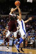 Texas A&M forward Kristi Bellock, left, blocks a shot by UK guard Jennifer O'Neill in the second half. The University of Kentucky Women's Basketball Team hosted Texas A&M, Thursday, Jan. 10, 2013 at Memorial Coliseum in Lexington. Photo by Jonathan Palmer