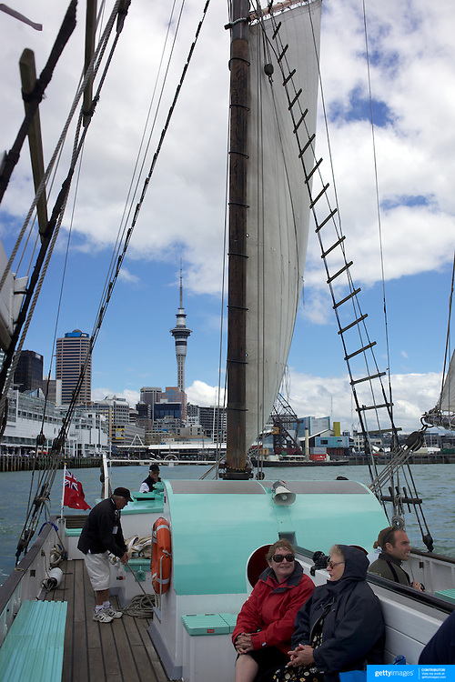 Tourists on the Historic Scow which sails for tourists form the NZ Maritime Museum, on the Auckland Harbour. Auckland, New Zealand, 4th November 2010. Photo Tim Clayton.