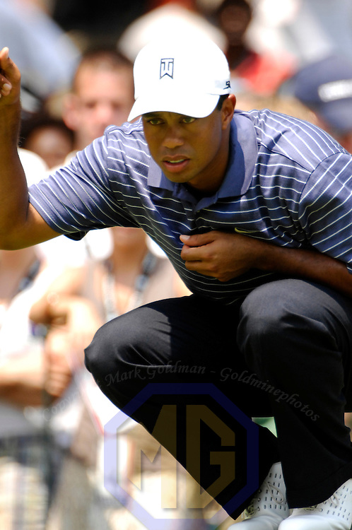 07 July 2007:  Tiger Woods looks to line up a putt on the 8th hole in the third round of the inaugural AT&T National PGA event at Congressional Country Club in Bethesda, Md.  ****For Editorial Use Only****