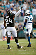 Jacksonville Jaguars defensive end Dawuane Smoot (94) waves his arms as he celebrates at the end of the NFL week 13 regular season football game against the Indianapolis Colts on Sunday, Dec. 2, 2018 in Jacksonville, Fla. The Jaguars won the game in a 6-0 shutout. (©Paul Anthony Spinelli)