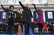 Mayor Bill De Blasio, accompanied by his wife Chirlane McCray, daughter Chiara, and son Dante, greet the crowd  after he is sworn in as the 109th Mayor of New York City  during an inaugural ceremony at City Hall.