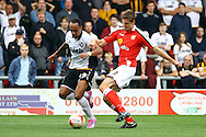 Port Vale&rsquo;s Byron Moore and Crewe Alexandre&rsquo;s Jon Guthrie battle for the ball. Skybet football league one match, Crewe Alexandra v Port Vale at the Alexandra Stadium in Crewe on Saturday 13th Sept 2014.<br /> pic by Chris Stading, Andrew Orchard sports photography.