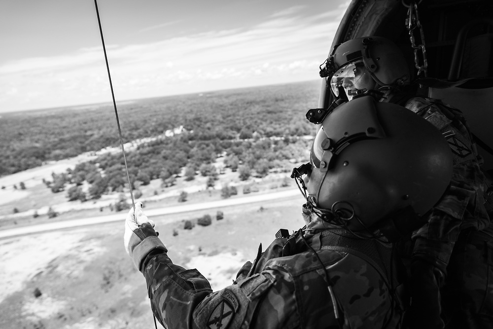 MEDEVAC Crew members conduct a Rescue Hoist check prior to beginning Rescue Hoist Operations