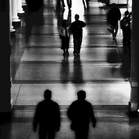 Figures walking in a railway station
