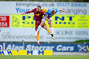 Tom Aldred (#5) of Motherwell FC and Callum Hendry (#22) of St Johnstone FC jump for a header during the Ladbrokes Scottish Premiership match between St Johnstone and Motherwell at McDiarmid Stadium, Perth, Scotland on 11 May 2019.