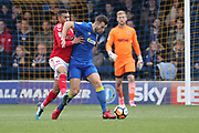 AFC Wimbledon defender Jon Meades (3) battles for possession with Charlton Athletic forward Karlan Ahearne-Grant (18) during the The FA Cup match between AFC Wimbledon and Charlton Athletic at the Cherry Red Records Stadium, Kingston, England on 3 December 2017. Photo by Matthew Redman.