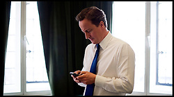 Leader of the Conservative Party David Cameron using his Blackberry in his office in Westminster, London, Wednesday March 17,2010 .Photo By Andrew Parsons / i-Images