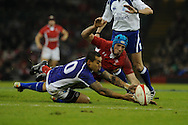 Justin Tipuric of Wales ® dives for the ball with Samoa's Tusiata Pisi.  Dove Men series, autumn international rugby international, Wales v Samoa at the Millennium stadium,  Cardiff in South Wales on Friday 16th November 2012.  pic by Andrew Orchard, Andrew Orchard sports photography,