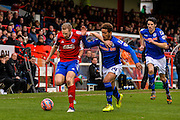 Mark Molesley holds off Bastien Hery during the The FA Cup match between Aldershot Town and Rochdale at the EBB Stadium, Aldershot, England on 7 December 2014.