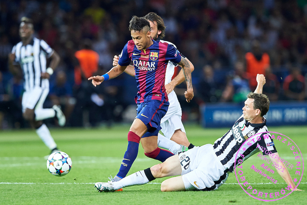 (L) Neymar of FC Barcelona fights for the ball with (R) Stephan Lichtsteiner from Juventus during the 2014/15 UEFA Champions League Final between Juventus and FC Barcelona at Olympiastadion on June 6, 2015 in Berlin, Germany.<br /> Germany, Berlin, June 6, 2015<br /> <br /> Picture also available in RAW (NEF) or TIFF format on special request.<br /> <br /> For editorial use only. Any commercial or promotional use requires permission.<br /> <br /> Adam Nurkiewicz declares that he has no rights to the image of people at the photographs of his authorship.<br /> <br /> Mandatory credit:<br /> Photo by &copy; Adam Nurkiewicz / Mediasport