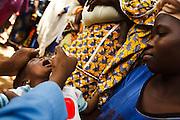 Vaccinator Bala Diakite vaccinates a child  against polio in the village of Banankoro, Mali on Saturday August 28, 2010.