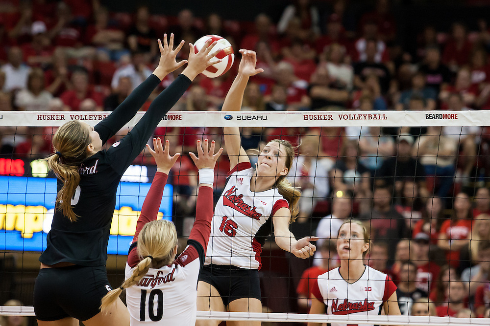 August 31, 2014: Nebraska setter Mary Pollmiller #16 blocked by Stanford outside hitter Brittany Howard #16 in the second set at the Devaney Sports Center in Lincoln, Nebraska. Stanford 3 Nebraska 0. Photo by John S. Peterson.