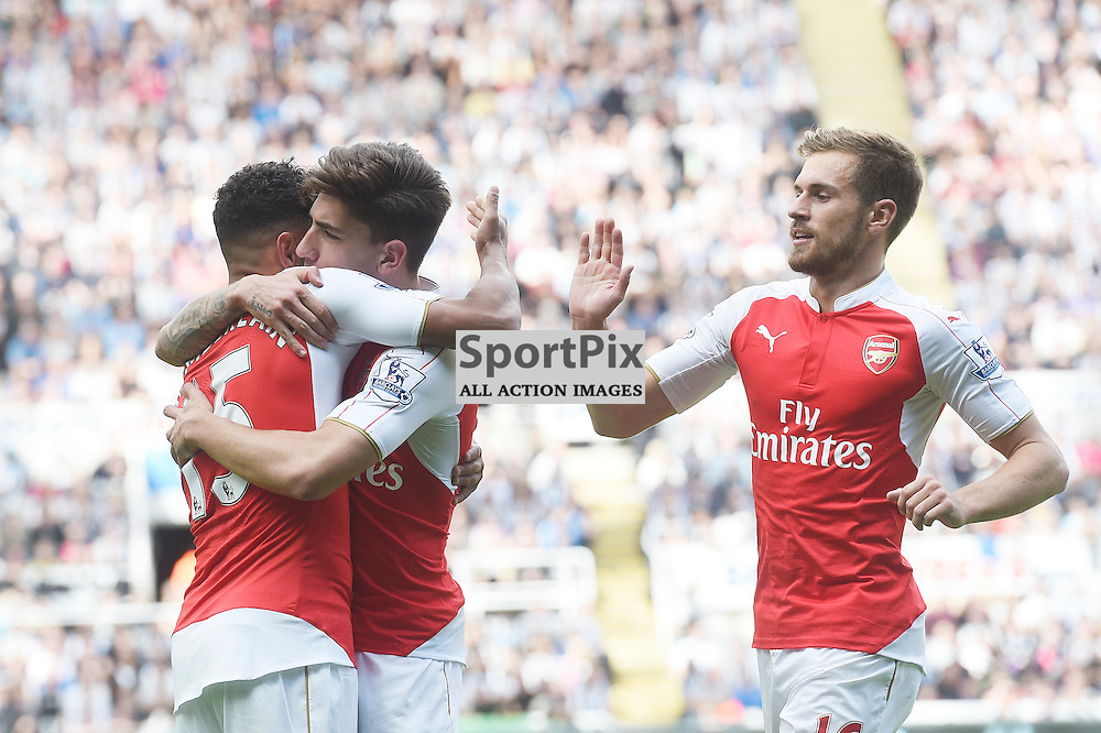 Arsenal team celebrate Alex Oxlade-Chamberlain's goal Alex Oxlade-Chamberlain (left), Hector Bellerin (middle) and Aaron Ramsey (right) in the Newcastle United v Arsenal Barclays Premier League match at St James' Park Newcastle 09 August 2015<br /> <br /> (c) Greg Macvean / SportPix.org.uk