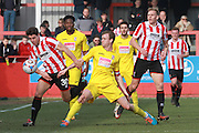 Dan Holman and Mark Ricketts during the Vanarama National League match between Cheltenham Town and Woking at Whaddon Road, Cheltenham, England on 12 March 2016. Photo by Antony Thompson.