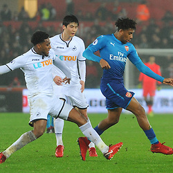 Alex Iwobi of Arsenal is challenged by Leroy Fer of Swansea City during Swansea City vs Arsenal, Premier League, 30.01.18 (c) Harriet Lander | SportPix.org.uk