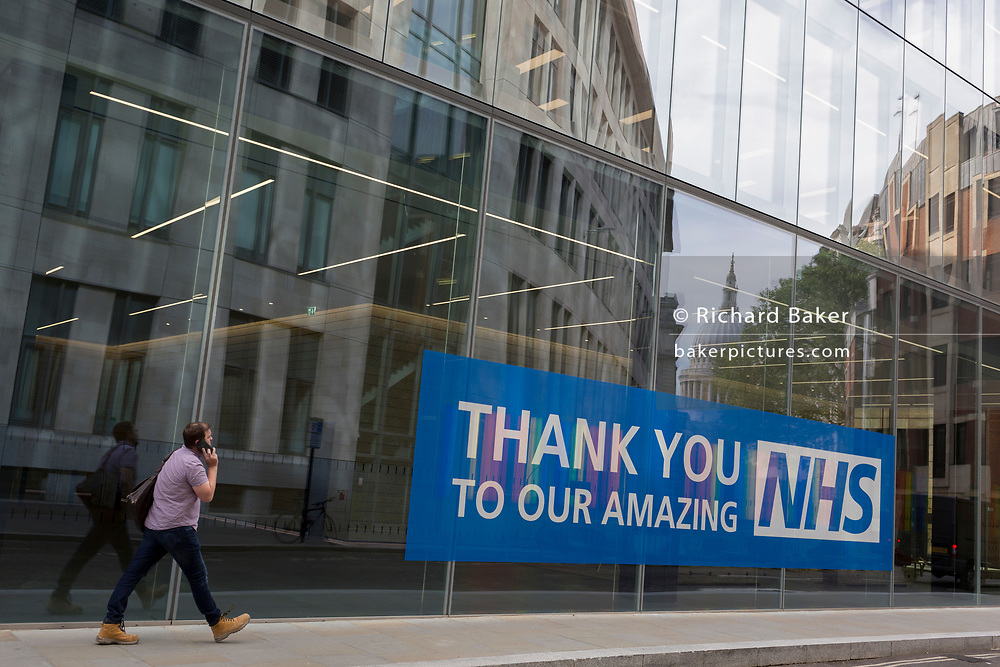 Ten weeks after the UK went into Coronavirus pandemic lockdown, the Office for National Statistics reveal that the total death toll has passed 50,000 covid-19 victims, a large banner thanking and supporting NHS (National Health Service) key workers, is outside newly-completed offices in the City of London, the capital's financial district, on 2nd June 2020, in London, England.