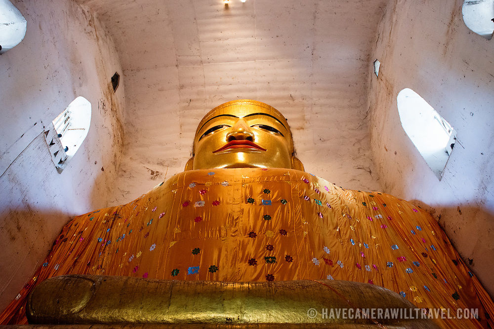 Built in 1067, Manuha Temple features massive statues of the The Buddha crammed within spaces barely large enough to hold them. An especially large reclining Buddha is a particular highlight. The temple is located in Myinkaba Village inside the Bagan Archaeological Zone.