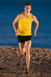 Exmouth, England, 20th June 2012. Long distance County runner, Tom Merson in action.