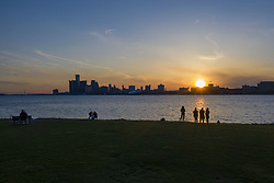 April 28, 2019 - Detroit, Michigan, U.S. - Detroit, Michigan - People watch a sunset over downtown Detroit from Belle Isle in the Detroit River. (Credit Image: © Jim West/ZUMA Wire)