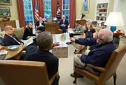 October 7, 2016 - Washington, DC, United States of America - U.S President Barack Obama is given an update on Hurricane Matthew from FEMA Administrator Craig Fugate and his national security team in the Oval Office of the White House October 7, 2016 in Washington, DC. (Credit Image: © Pete Souza/Planet Pix via ZUMA Wire)
