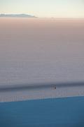 Cyclist through the Salt desert. Salar de Uyuni
