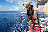 North Atlantic Ocean, October 2014.<br /> North Atlantic Ocean, October 2014.<br /> Marine biologist Adam Porter collects sea water for his plankton samples, on board the Sea Dragon.  &copy; Chiara Marina Grioni