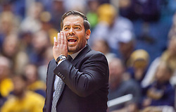 Nov 28, 2016; Morgantown, WV, USA; Manhattan Jaspers head coach Steve Masiello calls out a play during the first half against the West Virginia Mountaineers at WVU Coliseum. Mandatory Credit: Ben Queen-USA TODAY Sports