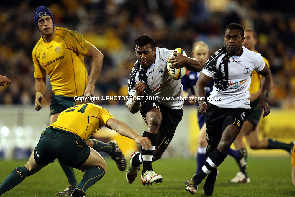 Timoci Nagusa takes on Drew Mitchell<br /> International Test rugby union match, Australia v Fiji, Canberra, Australia. Saturday 5 June 2010. Photo: Paul Seiser/PHOTOSPORT