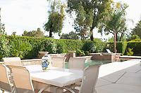 Cream dining furniture at poolside