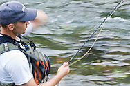 Fly fishing for trout on the Gallatin River in Montana.