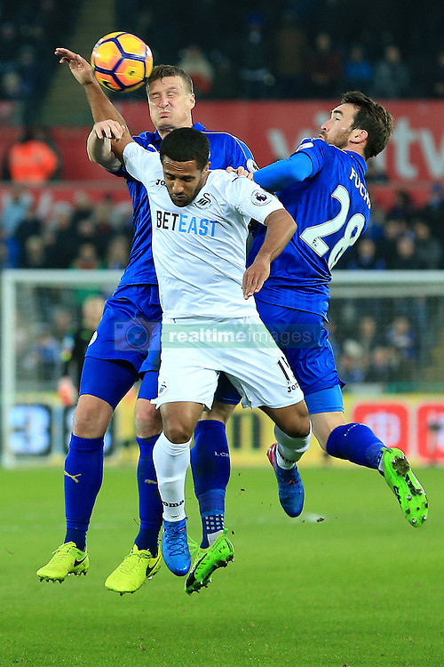 12 February 2017 - Premier League - Swansea City v Leicester City - Robert Huth and Christian Fuchs of Leicester City battle Wayne Routledge of Swansea City for a header - Photo: Paul Roberts / Offside
