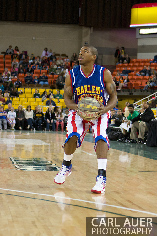 April 30th, 2010 - Anchorage, Alaska:  Buckets Blakes pulls up with the Military Tribute ball to shoot a 3 point shot in the Globetrotters game against the Washington Generals at the Sullivan Arena.