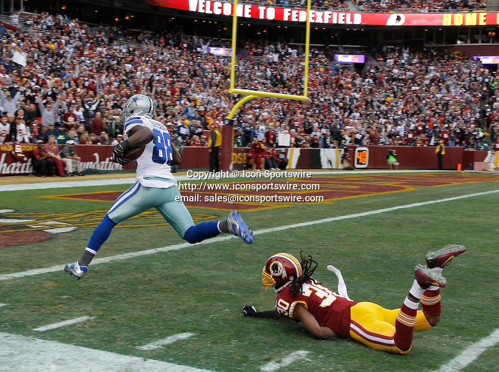 Dec. 28, 2014 - Landover, MD, USA - Dallas Cowboys wide receiver Dez Bryant (88) runs into the end zone in the first quarter as Washington Redskins free safety E.J. Biggers (30) falls away at the three yard line as the Dallas Cowboys play the Washington Redskins on Sunday, Dec. 28, 2014 at FedEx Field in Landover, Md. The Cowboys won 44-17
