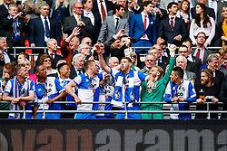 Players celebrate during the trophy presentation after Bristol Rovers win the match on penalties  to secure promotion to the Football League 2 - Photo mandatory by-line: Rogan Thomson/JMP - 07966 386802 - 17/05/2015 - SPORT - FOOTBALL - London, England - Wembley Stadium - Bristol Rovers v Frimsby Town - Vanarama Conference Premier Play-off Final.
