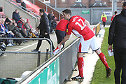 12 Eddie Nolan for Crewe Alexander leads the team in handing shirts out to disabled fans during the EFL Sky Bet League 2 match between Crewe Alexandra and Lincoln City at Alexandra Stadium, Crewe, England on 26 December 2018.