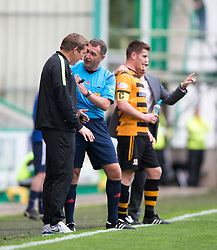 Ref John McKendrick at Hibernian's manager Alan Stubbs after Alloa Athletic's Colin Hamilton brought down Hibernian's James Keating for a first half penalty claim. <br /> Hibernian 3 v 0 Alloa Athletic, Scottish Championship game played 12/9/2015 at Easter Road.