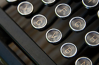 Close-up of antique typewriter keys.