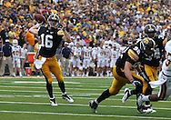 September 3, 2011: Iowa Hawkeyes quarterback James Vandenberg (16) throws a pass during the first half of the game between the Tennessee Tech Golden Eagles and the Iowa Hawkeyes at Kinnick Stadium in Iowa City, Iowa on Saturday, September 3, 2011. Iowa defeated Tennessee Tech 34-7 in a game stopped at one point due to lightning and rain.