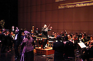Guest conductor Bruce Duke of Kettering, the high bidder in the silent auction for this postion, leads the Dayton Philharmonic Orchestra and Bob Gray Orchestra as they play Hang on Sloopy during the Dayton Performing Arts Alliance Inaugural Gala at the Schuster Center in downtown Dayton, Saturday, October 5, 2013.