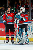 KELOWNA, BC - NOVEMBER 20:  Jake Lee #21 takes a quick drink while standing at the net with Roman Basran #30 of the Kelowna Rockets while a play is under review on a goal scored by Sean Gulka #17 of the Victoria Royals at Prospera Place on November 20, 2019 in Kelowna, Canada. (Photo by Marissa Baecker/Shoot the Breeze)